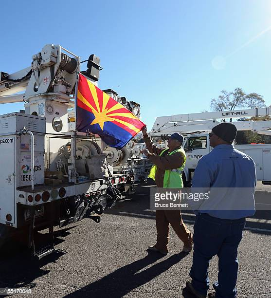 An electrical work crew from Arizona props their state flag on the back of their truck in Port Jereson Harbor in the aftermath of Superstorm Sandy on...