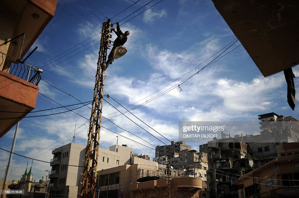An electrician fixes electricity wires in the neighbourhood of Bab ...