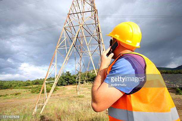 An electrician looking at a tower