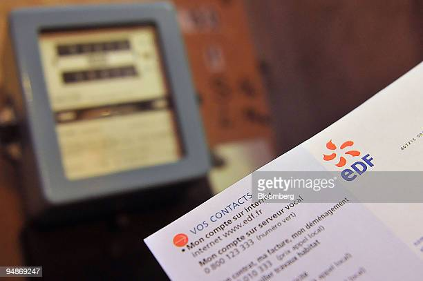 An Electricite de France SA bill is arranged next to an electricity meter in Paris France on Tuesday July 29 2008 British Energy Group Plc the UK's...