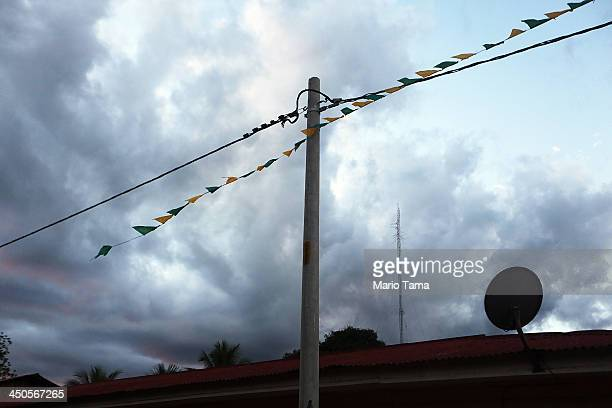 An electricity line hangs in a deforested section along the Interoceanic Highway in the Amazon lowlands on November 18 2013 in Planchon Madre de Dios...