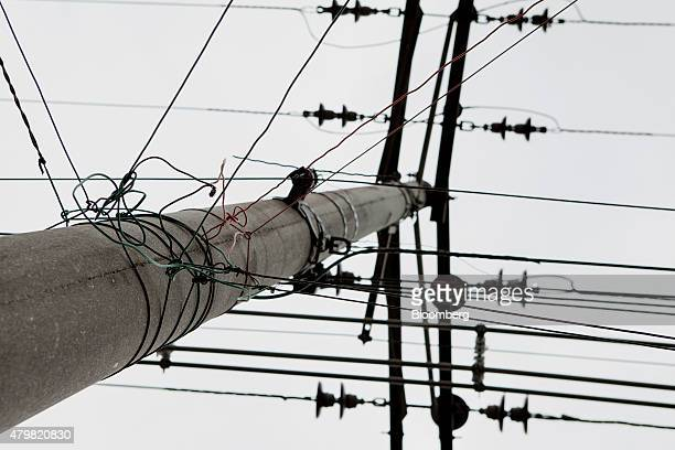 An electricity pole stands in the Dilma Rousseff favela of Rio de Janeiro Brazil on Monday July 6 2015 As the fastest inflation in more than a decade...