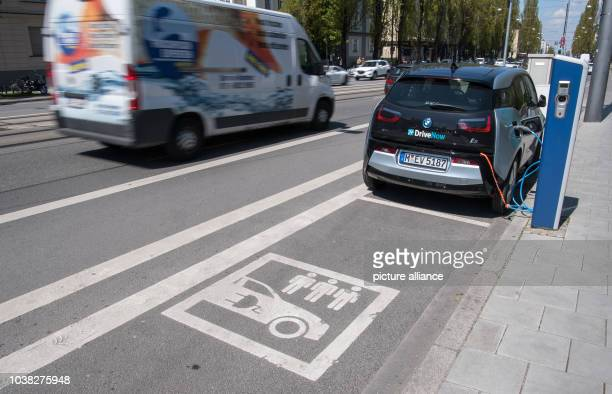 An electricity powered car is being recharged at a fuel station for electricty powered cars in Munich Germany 29 April 2016 The 'Bayerische...