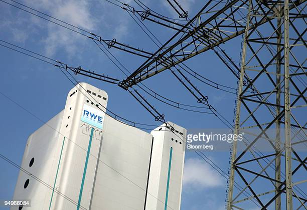 An electricity pylon stands in front of the RWE AG owned coalfired power station in Niederaussem Germany on Tuesday Aug 11 2009 RWE announce earnings...