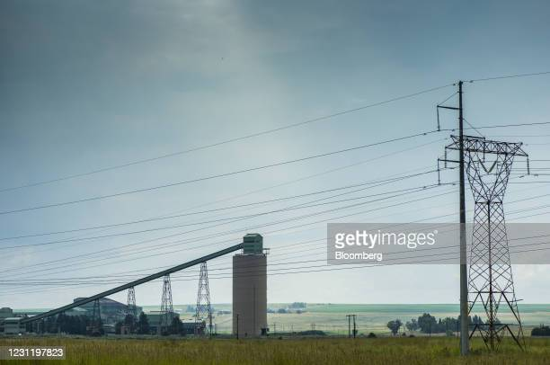 An electricity transmission plylon near the coal conveyor on the grounds of the Goedehoop coal mine, operated by Anglo American Plc, in Mpumalanga,...