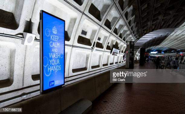 An electronic ad in the from the Centers for Disease Control advises commuters and tourists in the Metro Center subway station in Washington to keep...