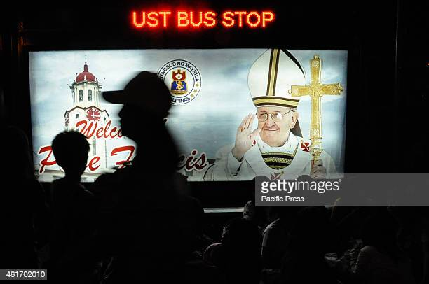 An electronic billboard bearing the image of Pope Francis is displayed at a waiting shed near the Gate 2 of University of Santo Tomas along Espana St...