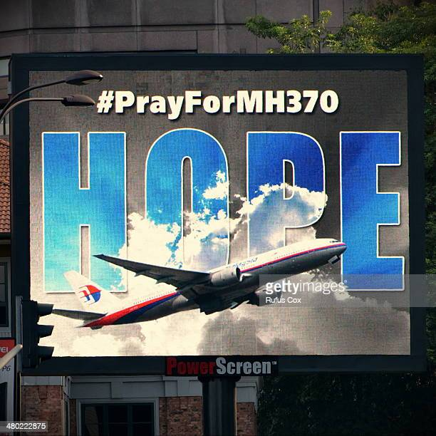 An electronic billboard displays a message relating to missing Malaysian Airlines flight MH370 on March 23 2014 in Kuala Lumpur Malaysia The search...