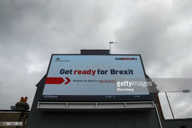 An electronic billboard features the the UK government's Get ready for Brexit advertising campaign in the Tolworth district of London UK Monday Sept...