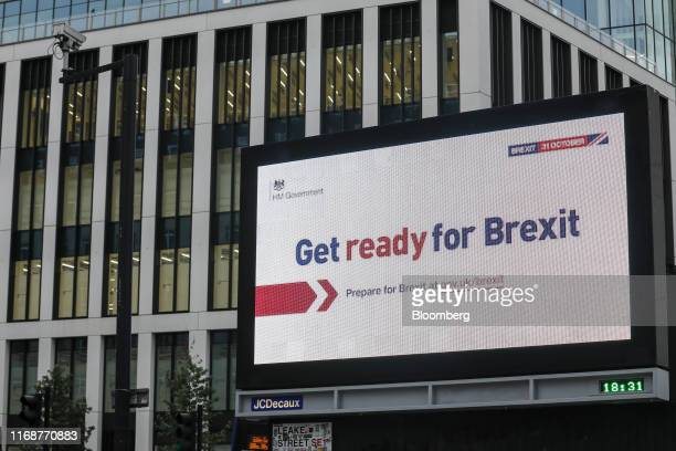 An electronic billboard features the the UK government's Get ready for Brexit advertising campaign in the Waterloo district of London UK on Monday...