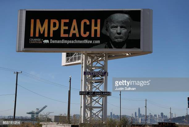 An electronic billboard next to the San FranciscoOakland Bay Bridge reads IMPEACH with an image of US President Donald Trump on September 25 2017 in...