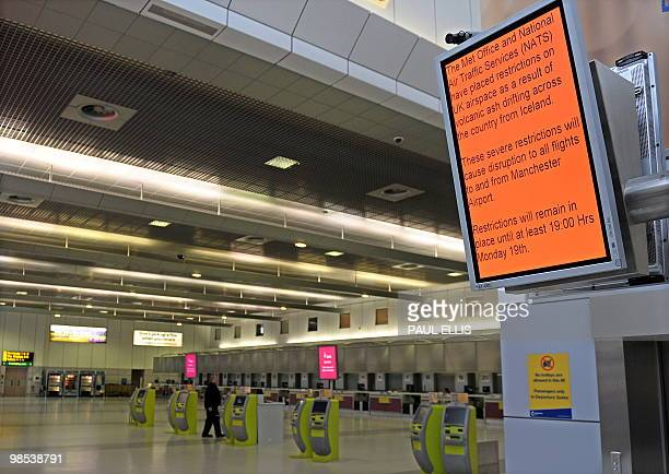 An electronic board advising passengers of flight disruptions due to volcanic ash is pictured in a empty departure lounge at Manchester Airport in...