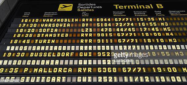 An electronic board displays departures in terminal 2B at Barcelona's El Prat airport on March 24 2015 after a Germanwings airliner crashed near a...