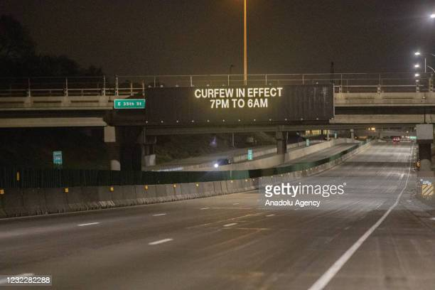 An electronic board over an interstate tells drivers that a curfew is in effect from 7PM until 6AM as protests over police killing of Daunte Wright...