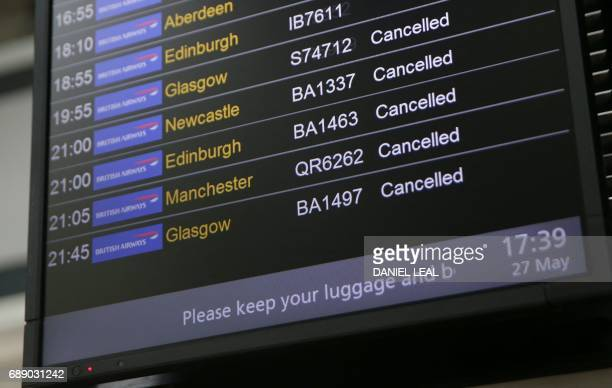 An electronic board shows British Airways flights cancelled at Heathrow Airport Terminal 5 in west London on May 27 2017 British Airways said May 27...