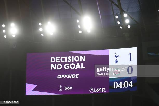 An electronic board shows the decision of a VAR review ruling an early goal by Tottenham Hotspur's South Korean striker Son Heung-Min to be offside...