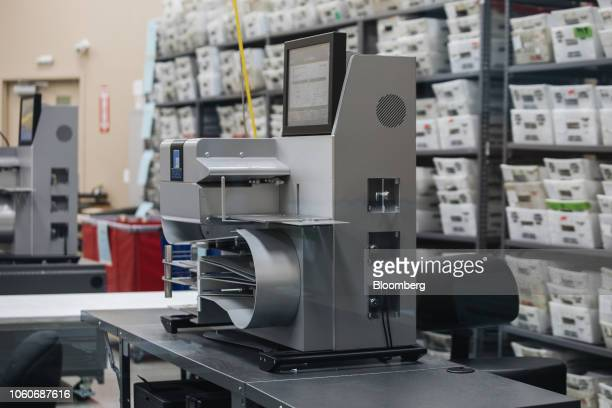 An electronic counting machine sits on a table during a recount at the Broward County Supervisor of Elections office in Lauderhill Florida US on...