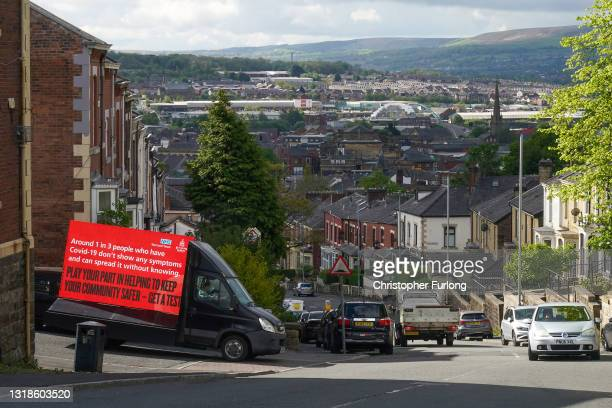 An electronic Covid-19 warning billboard drives around the streets in Blackburn as the Indian variant of coronavirus causes concern for health...