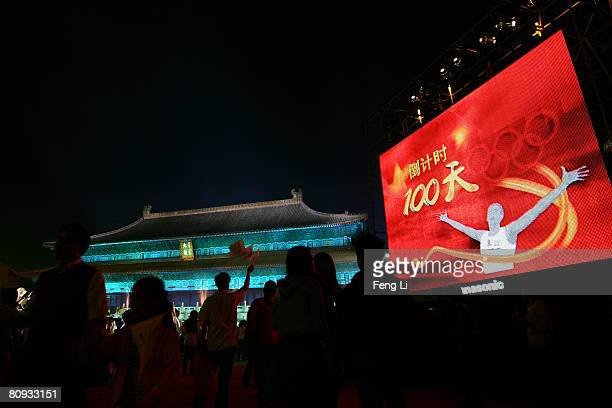 An electronic display is seen as the audience watches the performance during the Award-giving Ceremony for the Fourth Olympic Songs Competition at...