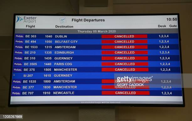 An electronic flight departure board displays 'cancelled' status's for all Flybe flights due to have taken-off from Exeter Airport in Exeter,...