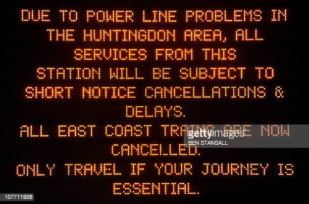 An electronic information board displays a notice to passengers informing them of short notice cancellations and delays at Kings Cross train station...