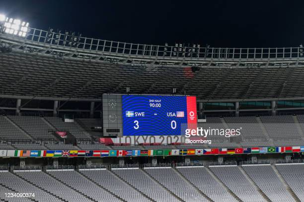 An electronic scoreboard in an empty stand during an opening round women's football match between the U.S. And Sweden at the Tokyo 2020 Olympic Games...