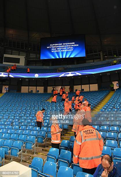 An electronic screen displays a message in German saying 'due to adverse weather conditions today's match was cancelled' inside the Etihad stadium in...