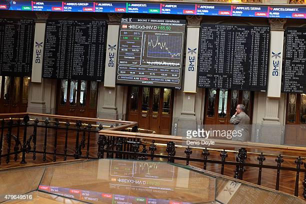 An electronic screen shows the Spanish IBEX 35 index at the Madrid stock exchange a day after Greeks voted in a referendum to reject the European...