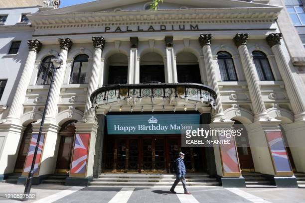 """An electronic sign above the entrance to the London Palladium theatre, closed-down due to COVID-19, reads """"Happy Birthday Ma'am"""", a birthday wish for..."""