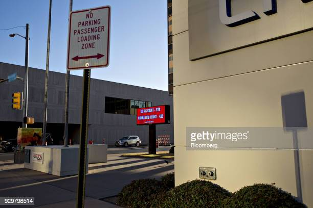 An electronic sign displays the number of oil rigs operating in the US and the Permian Basin outside an office building in downtown Midland Texas US...