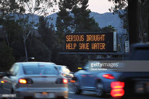 An electronic sign near the 134 freeway warns of serious drought conditions and encourages people to use less water on February 11 2014 in Glendale...