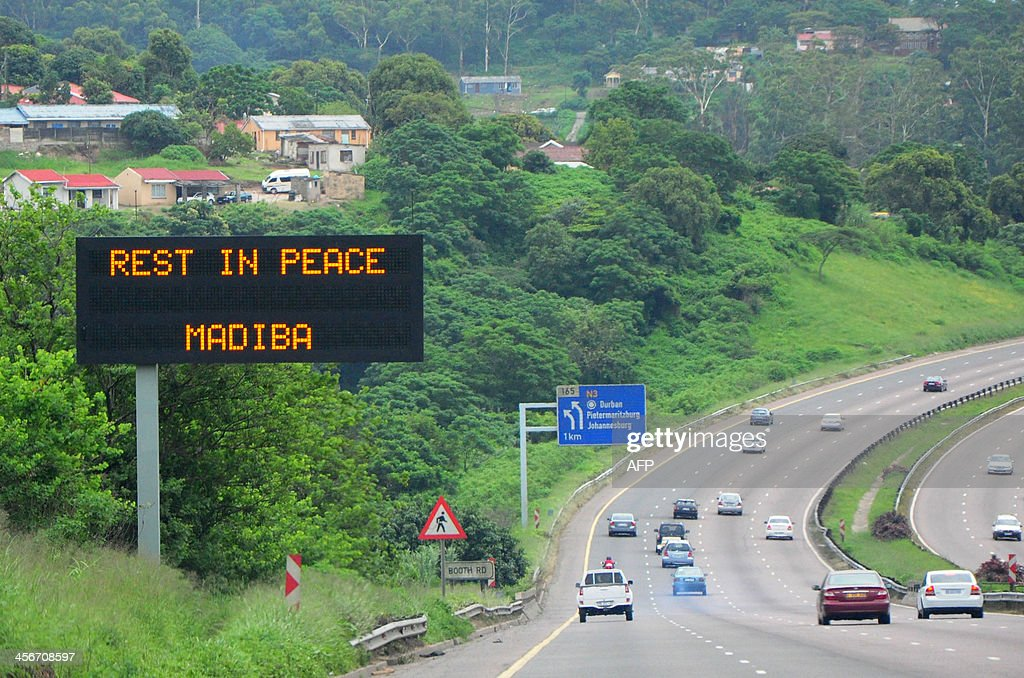 An electronic sign on the side of a road in Durban presents a message in honor of late former South African President Nelson Mandela, on the day of Mandela's burial in his hometown of Qunu, on December 15, 2013. Mandela was buried near his homestead Qunu today, ending 10 days of national mourning and global tributes for the prisoner-turned-president who transformed his country and inspired the world. AFP PHOTO / Anesh Debiky
