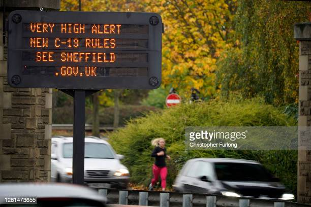 "An electronic sign warns the people of Sheffield of the 'Very High"" risk on October 22, 2020 in Sheffield, England. The county of South Yorkshire,..."