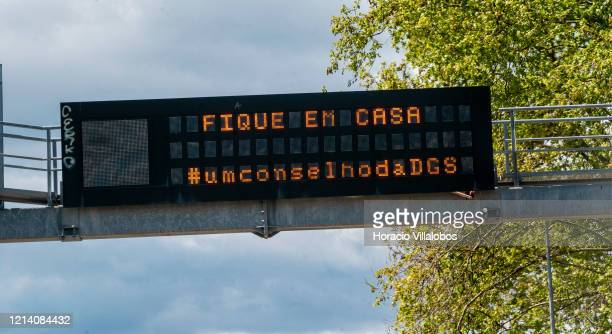 An electronic traffic alert sign displays a Stay at Home message from the Portuguese Directorate General of Health due to the COVID19 Coronavirus...