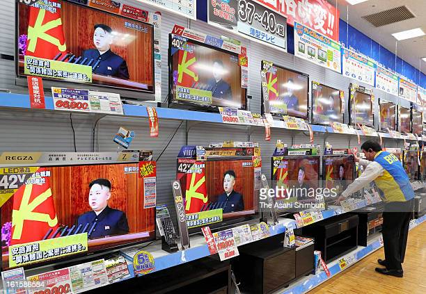 An electronics store staff arranges a televsion broadcasting reporting the North Korea's nuclear test on February 12 2013 in Tokyo Japan North Korea...
