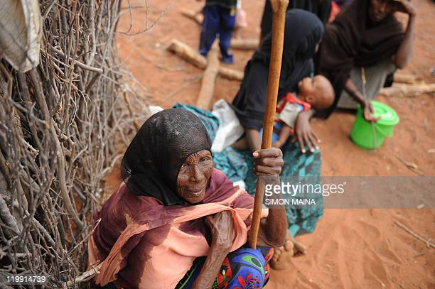 An elederly woman sits as she waits for food ratios at a feeding center in Lolkuta near Wajir on July 21 2011 The UN's World Programme Programme was...