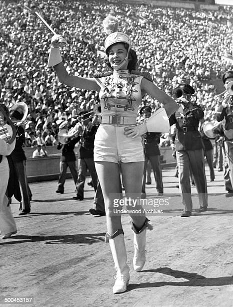 An elegant Mississippi majorette leads a contingent as they march through the Los Angeles Coliseum in the annual American Legion parade Los Angeles...