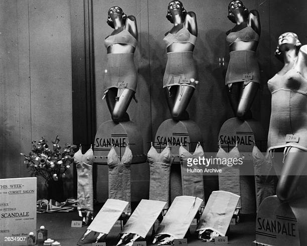 An elegant window display of Scandale corsets and suspenders.