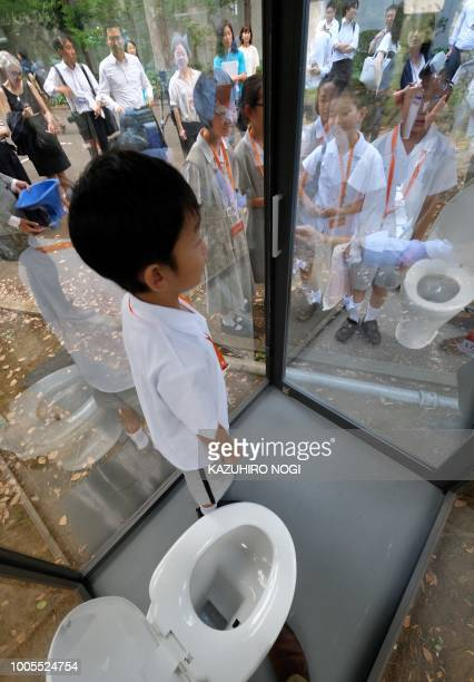 An elementary school student standing inside a public toilet on display looks out through oneway glass during a special interactive class with...