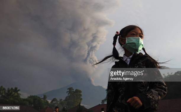 An elementary school student with a face mask is seen in a school ground before school in Rendang village of Karangasem Bali Indonesia on November 28...