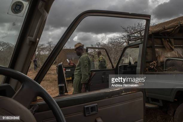 An elephant collaring team takes a break during an operation on February 2 2018 in an area of ranches in TaitaTaveta County Kenya The operation run...