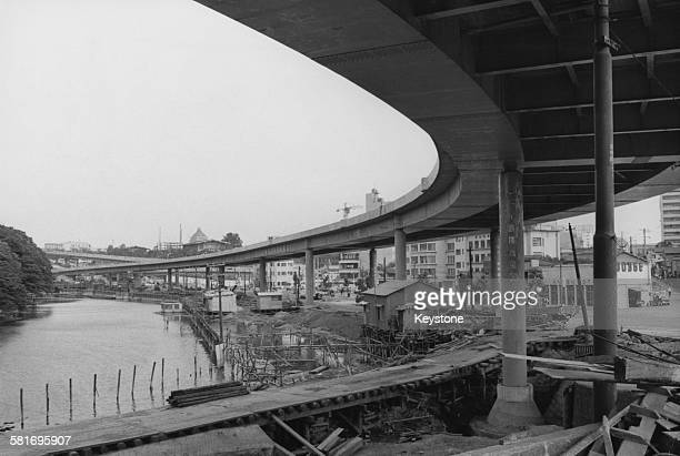 An elevated expressways being built in the Akasaka-mitsuke area of Tokyo, Japan, in preparation for the Tokyo Olympics, 1964.