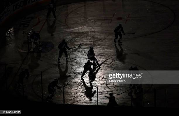 An elevated general view of silhouetted players in game action is seen in the first period of the 2020 NHL Stadium Series game between the Los...