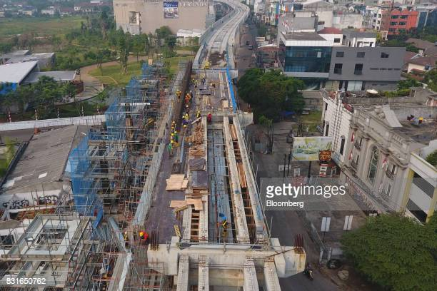 An elevated track for the Jakarta Mass Rapid Transit stands under construction in this aerial photograph taken in Jakarta Indonesia on Sunday Aug 13...