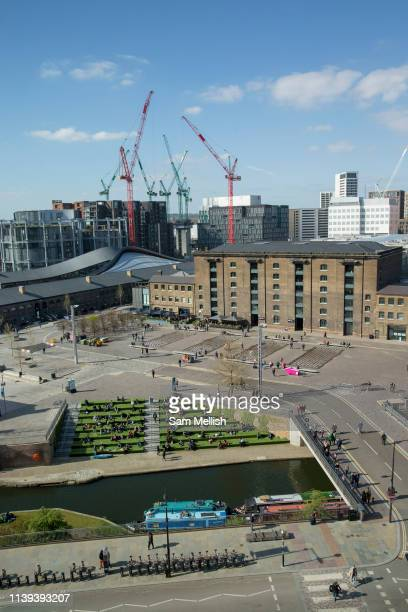 An elevated view across Regents Canal towards Central Saint Martins college in Granary Square with new building developments in the background on the...