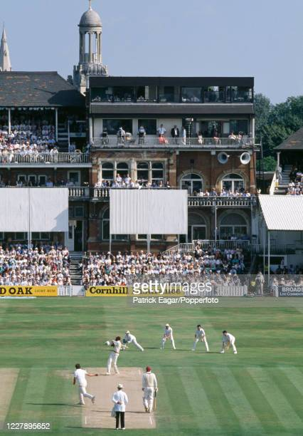 An elevated view down the ground towards the pavilion as Curtly Ambrose of West Indies pulls a delivery from Derek Pringle of England during the 5th...