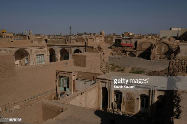 An elevated view of historical houses in the state of ruins in the city centre on July 23, 2018 in Kashan, Iran. A group of people from different...