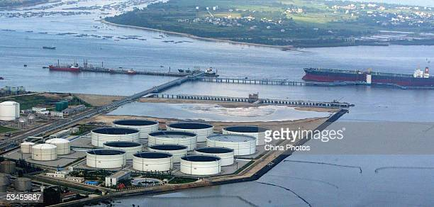 An elevated view of oil tanks is seen on August 4 2004 in Zhanjiang of Guangdong Province south China The nation's largest oil and gas producer China...