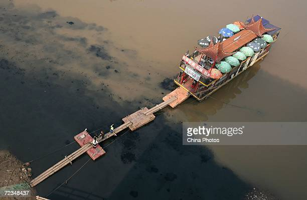 An elevated view of polluted water near a hulk which was transformed as a restaurant on the Jialing River is seen on November 2 2006 in Chongqing...