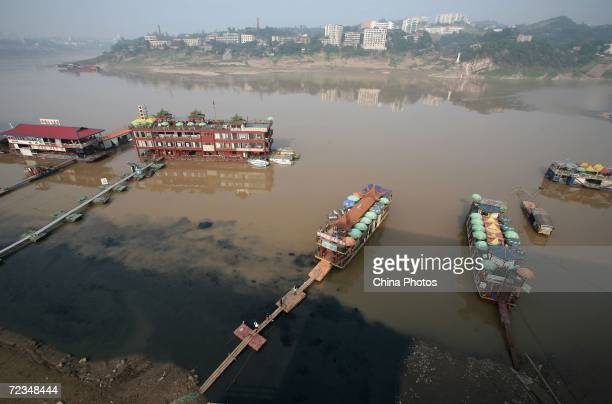 An elevated view of polluted water near hulks which were transformed as restaurants on the Jialing River is seen on November 2 2006 in Chongqing...